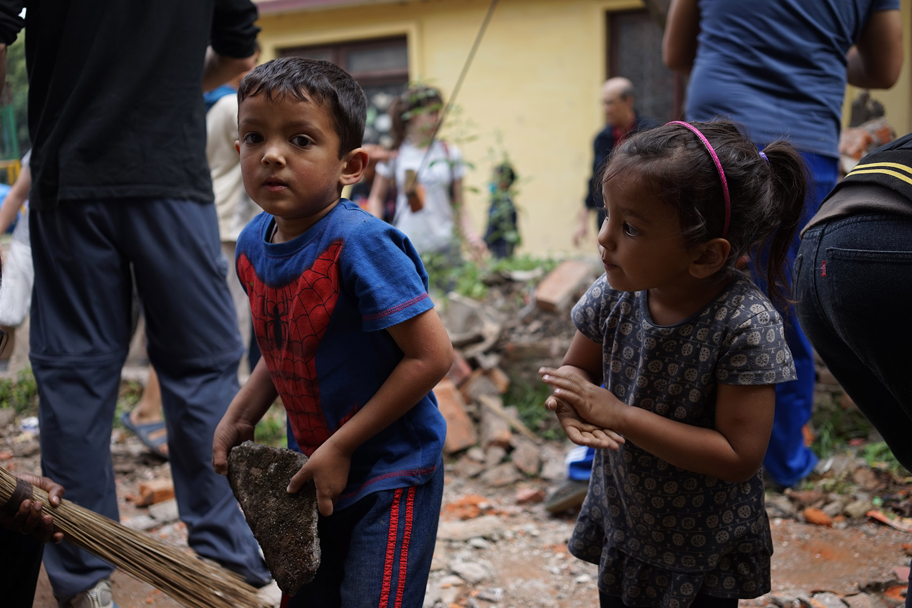 Children helping cleaning up rubble after the earthquake