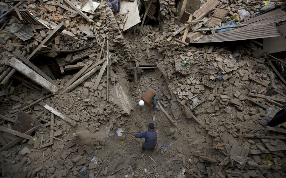 People search for family members trapped inside collapsed houses in Bhaktapur