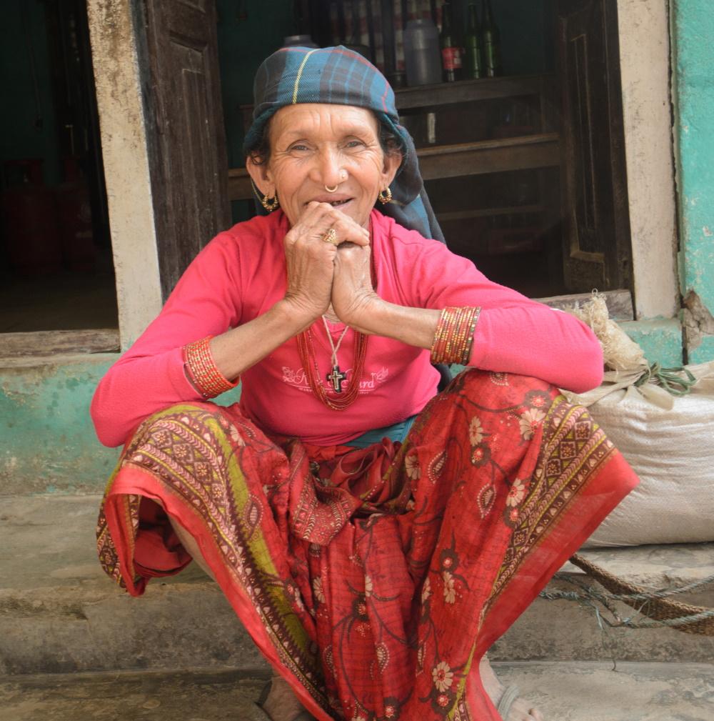 Nepali lady sat on doorstep