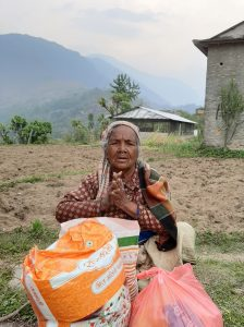 Lady in Nepal receives a food package from ACN