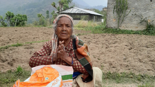 Woman getting food package from ACN in Nepal