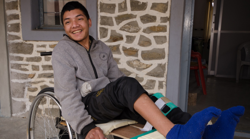 Boy in wheelchair at INF hospital in Nepal