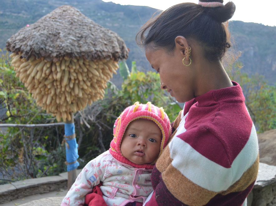 A mother and her baby in Kalikot, a remote western district where INF Nepal is delivering a community resilience and development project.